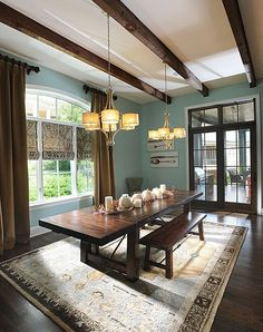 Bench seating + area rug = cozy dinner party. #DreamHome #rustic #interiordesign