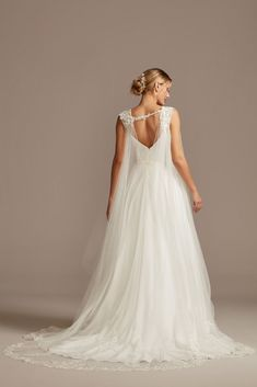 This long tulle cape with a sweep-length train adds an air of drama to a simple or romantic wedding dress. Lace applique covers the shoulders and hemline for finishing flourish. Lace Styles For Wedding, Simple Wedding Gowns, Affordable Wedding Dresses, Wedding Ideas, Wedding Inspiration, Wedding Dress Suit, Low Key Wedding Dress, Wedding Cape Veil, One Shoulder Wedding Dress