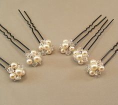 Cream Pearl Wedding Hair Accessories, Bridal Hairpins, Bridal Hair, Pearl and Crystal Hair Pins, available with either white or cream pearls. $35.00, via Etsy.