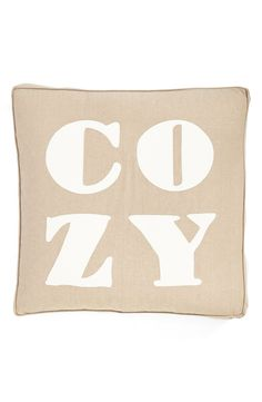 This thick, plump 'COZY' pillow will make a cute addition to the living room decor.