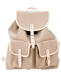 Beige canvas backpack from Essl featuring leather trimming, double shoulder straps, a buckled closure and two front pockets.