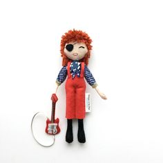 David Bowie Rebel Rebel Rock Star Doll, Music Icon, Glam Rock Style Doll, Doll with Guitar, Specialty Doll, Limited Edition Doll Collector READY TO SHIP WITHIN 7-10 BUSINESS DAYS, for more accurate date please contact me before placing your order. Musician Collection. Art doll will be snuggled in a tissue paper in kraft gift box. Personalised message can be added to the gift box (please leave your message in the note from the buyer field at the check out. Size: about 18cm tall. Felt a...