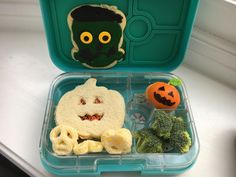 PBFluff jack-o-lantern sandwich, skull cheese puffs, jack-o-lantern orange, broccoli, Frankenstein cookie we made over the weekend  :)