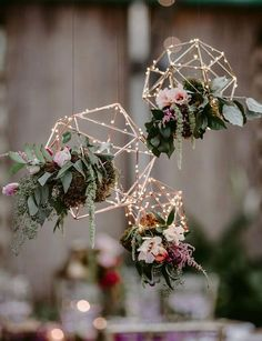 Suspended Floral Geo Shapes As Wedding Decor ~ Love these mossy little arrangements and the shapes outlined with fairy lights by Papertini