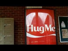 Short on change? This vending machine gives out free Coke in exchange for hugs.
