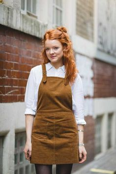 Rosin Kay, Features Intern at ELLE. Wearing a Beyond Retro pinafore dungaree dress, Zara shirt, Adidas trainers.