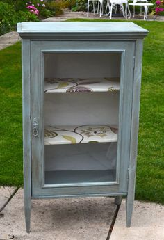vintage glass front display cabinet.