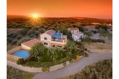 Sunset over Ioannis holiday rental Cottage with private garden, pool and children's area. Crete