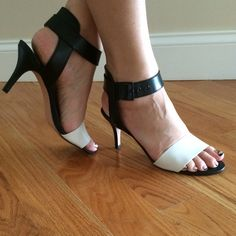 Saks Fifth Avenue heels Black and white shoes- worn once , look brand new. No scratches . The heel is 3 inches. Comes with it's original box. They are very comfortable!!!! Saks Fifth Avenue Shoes Heels