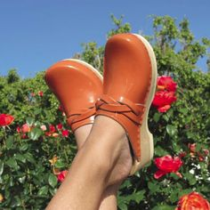 Lady showing off het clogs. Source: Clogs Love