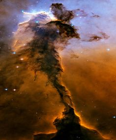 An image of the Eagle Nebula reveals a tall, dense tower of gas being sculpted by ultraviolet light from a group of massive, hot stars.