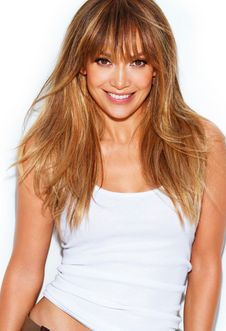 Mom says I have her features... I think I might attempt this look =) Jennifer Lopez caramel hair