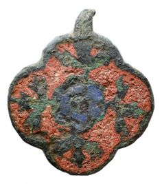 A quatrefoil-shaped harness pendant of the medieval period (13-14 C). Cast copper alloy. It bears a decorative design consisting of a central six-petalled flower and adjoining foliage in each lobe. The flower is inlaid with blue enamel, and the field with red enamel. Most of the enamel survives, but the suspension loop is broken. 33.8mm x 29.6mm, 9.12g. UKDFD 44750 Metal Detecting, Medieval Dress, Quatrefoil, 15th Century, Bears, Badge, Survival, It Cast, Enamel