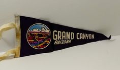 Grand Canyon, Arizona - Vintage Pennant  Feature: Grand Canyon, Arizona Length: 11 inches Age: 1970s Condition: Used, dirty, crinkly Image(s): Grand Canyon  All pennants are shipped in a bubble mailer or a box. If the pennant fits without being folded, it will be sent in a bubble mailer. If the pennant has an existing fold/crease (and many of them do at this stage of their lives), I may fold the pennant using the existing crease and send it in a bubble mailer. If neither of those solutio...