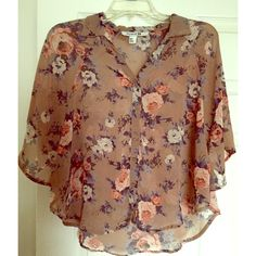 STUNNING  SHEER FLORAL TOP - MINT CONDITION This beautiful floral top features a beautiful floral pattern, batwing sleeves, and buttons down the front. It is very sheer, and flows beautifully. The color is exactly as shown. I did not enhance or use any filters on the photos. Worn once or twice. MINT CONDITION. TRADES PAYPAL Forever 21 Tops