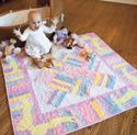 Soft Snuggles: Simple Flannel Strip Pieced Baby Quilt Pattern, featured in America Loves Scrap Quilts Winter 2012/2013