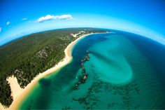 Moreton Island is the 3rd largest sand Island in the world.it is located in Moreton Bay on the Coast of Southeast Queensland. Australia.com. Photo by Aerial Advantage