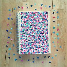 Cuaderno con pedacitos triangulares