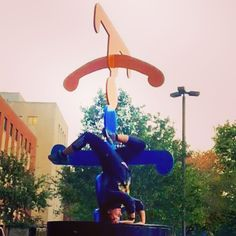 Pole instructor @bethany.time just had to join this headstand party while on her morning run. #headstand #sculpture #morningrun #thisiscle #cleveland #handstandmonth #invert #yoga #clevelandexoticdance #ced