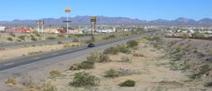 Over 2 Million Visitors a Year! Quartzsite, Arizona, barely 18 miles east of the Colorado river, on I-10, may be the RV boondocking capital of the world. Quartzsite has become a mecca to visitors and exhibitors for rocks, gems, mineral specimens and fossils during the town's famous two-month-long gem show and swap meet