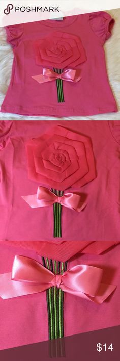 Pink Dimensional Flower Top New. No tag.   Toddler 2T - 3T. Tutu & Lulu.   Hot pink. Gathered short sleeves, scoop neck. Beautiful flower, stem & bow design on front.   95% cotton. 5% spandex. Tutu & Lulu Shirts & Tops