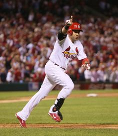 St. Louis Cardinals' Carlos Beltran runs to first after hitting the game-winning single in the bottom of the 13th inning during Game 1 of the National League Championship Series between the St. Louis Cardinals and the Los Angeles Dodgers on Friday, Oct. 11, 2013, at Busch Stadium in St. Louis. (AP Photo/St. Louis Post-Dispatch, Chris Lee)