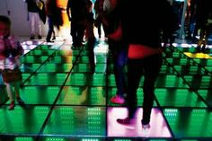 Energy Floors offers human-powered, interactive dance floors for event rentals worldwide. The eight-inch-deep tiles each house small generators; the tiles compress when stepped on, activating the generators to convert the kinetic energy produced by the dancers into electricity.