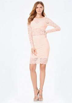 Seductive lace dress teasing with a strategic attached bralette and curve-defining skirt. Scalloped edges lend refined elegance. Adjustable straps. Back button-loop closure. Hidden back hook-and-eye and zip closure. Partially lined.
