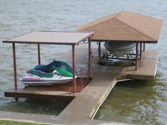 Here's a two slip covered boat dock with lifts.