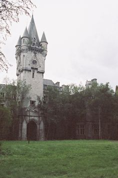 Abandoned Castle - The very stately entry tower has a clock and appears to have some kind if elevated lighting in the front. Abandoned Buildings, Abandoned Castles, Abandoned Mansions, Old Buildings, Abandoned Places, Beautiful Castles, Beautiful Buildings, Castle Ruins, Tower Castle