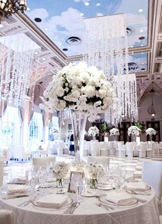 """-Aside from the incredible centerpieces, those chandeliers are SPECTACULAR!  Sanderling's Pavilion was built for decor like that.  I would love to see that done with seashells instead of crystals too!  """"Luxurious Wedding Centerpieces 