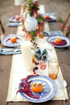 Russian Countryside centerpiece, candles, patterned plates, vibrant wintery colors, purples, oranges and blues. Florals, plants, white vases, european, boho, eclectic. Lauren Sharon Vintage Rentals and Design