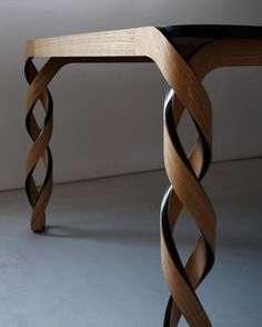 Paul Loebach's Watson table which was shown at Carwan Gallery has double-helix legs and is made of wood and carbon fiber. Paul Loebach's Watson table which was shown at Carwan Gallery has double-helix legs and is made of wood and carbon fiber. Unique Furniture, Wood Furniture, Furniture Design, Furniture Plans, Furniture Websites, Inexpensive Furniture, Furniture Online, Furniture Stores, Wood Projects
