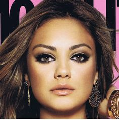 Here is a dramatic makeup look with the main focus being the eyes, with a nude lip, this look would suit an evening wedding.