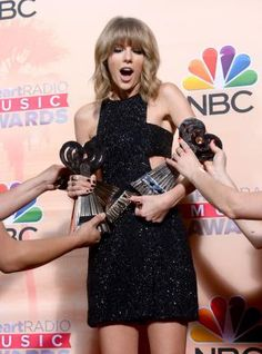 """Taylor Swift poses backstage with the awards for best lyrics for """"Blank Space,"""" song of the year for """"Shake It Off,"""" and artist of the year at the iHeartRadio Music Awards at the Shrine Auditorium in Los Angeles on March 29, 2015. Photo by Jim Ruymen/UPI"""