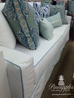 White slip cover couch with blue piping, throw pillows  www.pineapplespalms.com