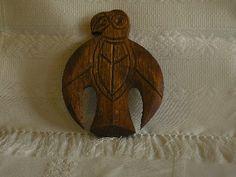 The Hungarian Turul bird. A wooden carving.