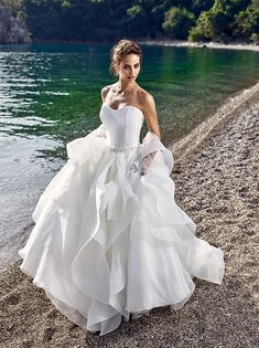 Love the layers for this Wedding Dress by Toscana – Wedding Dresses   Eddy K Bridal