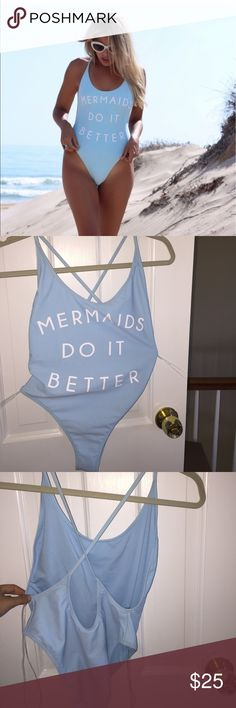 SWIM/BODYSUIT/MONOKINI ~~~~ MERMAIDS DO IT BETTER Baby blue one piece, worn once. Great for raves too. Shows some side boob and is a cheeky bottom and high cut on the thigh. One piece swimwear bathing suit summer mermaid blue graphic tags: mermaids, mermaid, swim, monokini, bathing suit, blue Swim One Pieces