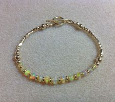A personal favorite from my Etsy shop https://www.etsy.com/listing/264090441/ethiopian-opal-gemstone-and-gold-filled