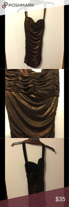 3/4 Brown Copper Dress I purchased this dress from the Boston Store for a school formal and it did not disappoint! It is a size 3/4 and clasps together behind the neck.  It has some great sparkle! Morgan & Co Dresses Mini