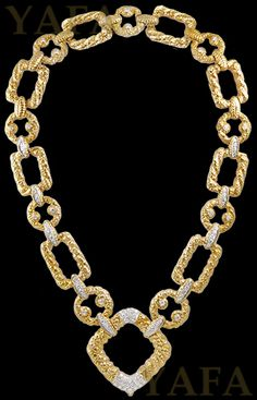 18k yellow gold and platinum diamond necklace, composed of rope twist-style links accented by round diamonds, signed Van Cleef & Arpels.