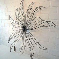 Sunburst, metal garden wall art...so pretty!!  I think I could make this.