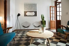 This fabulously decorated, midcentury Nordic meets Argentina, is set in an old renovated house in the historic district of Alberdi, one of the most traditional of Córdoba. It has four guest rooms, two shared bathrooms, a lounge and kitchen plus a courtyard garden. Helsinki, Checkerboard Floor, Shared Bathroom, Black And White Tiles, Tile Floor, Dining Table, Flooring, Modern, House
