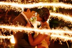 Use sparklers to create a magical wedding photo. | Captivating Weddings