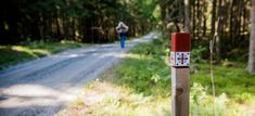 The World's Northernmost Pilgrimage Route Is in Norway—and Almost No One's Heard of It: The symbol on the red-and-white markers along the St. Olav Ways hints at the ancient trail's history and pays homage to its namesake. Cruise Vacation, Vacation Spots, Vacations, Hiking Norway, Louvre Pyramid, Huff And Puff, The Camino, Trondheim, Amsterdam Netherlands