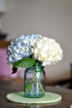 hydrangeas in blue mason jar but must add white sweetpeas!