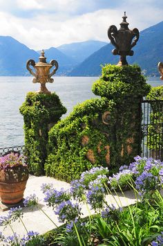 Villa Balbianello in Lenno on Lake Como, Italy - finials / urns, agapanthus - classical garden decor. This is just inspiration - Agapanthus in my Pensacola garden may be the closest I get to Italy! Places Around The World, The Places Youll Go, Places To See, Around The Worlds, Beautiful World, Beautiful Places, Comer See, Lake Como Italy, Foto Poster