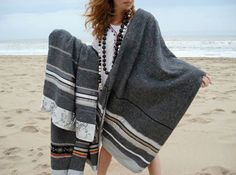 Dutch company, LADAK, pairs moving blankets with other materials including recycled sweaters, jeans, even parts of mattresses. The blanket is then further embellished with ribbons, decorative fabrics and lace. Each resulting blanket is completely unique — and gorgeous! posted originally from: AT:New York