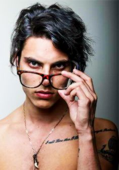 Celebrity with dreadlocks and glasses